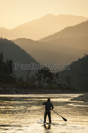 stand up paddleboarding on the karnali