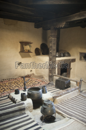 a ancient style kitchen with stone