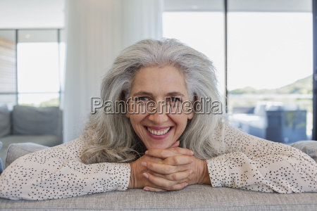 portrait happy mature woman leaning over