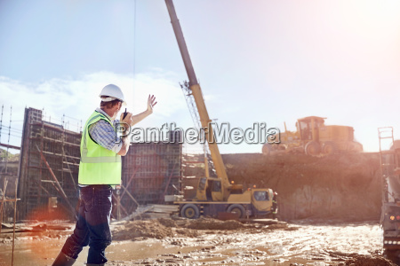 construction worker foreman using walkie talkie
