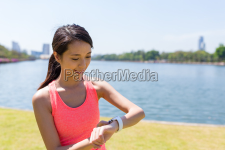 sport woman using smart watch to