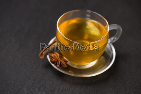 cup of black tea with spices