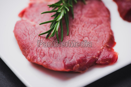 raw beef on a cutting board