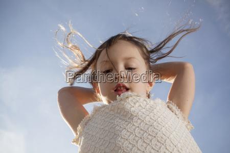 low angle shot of young girl