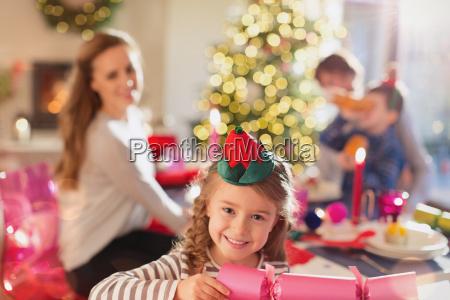 portrait smiling girl holding christmas cracker