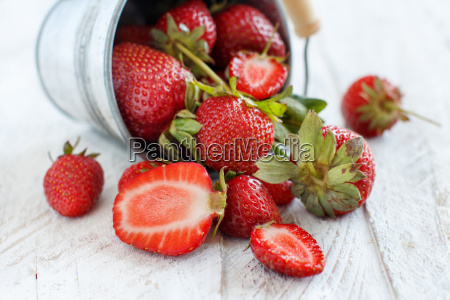 strawberries in a bucket on a