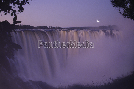 moonrise over victoria falls zimbabwe