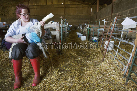 young woman sitting in a barn