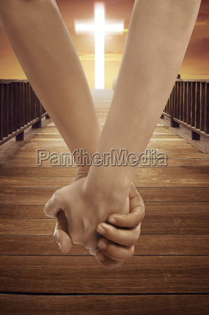 man and woman holding hand together