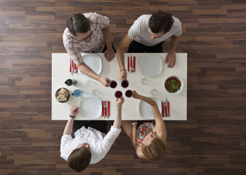 Group friends sitting around table having lunch