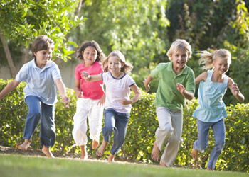 Group of chrildren playing in the garden in nature